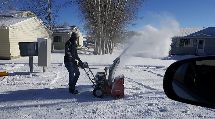snow blowing residential driveway